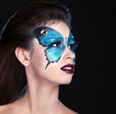 Face art portrait. Fashion Make up. Butterfly makeup on face bea — Stock Photo