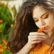 Outdoors portrait of Beautiful Teen girl smelling flower, over m — Stockfoto