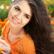Beauty woman portrait with flowers. Free Happy Brunette Enjoying — Stock Photo #41620369