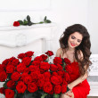 Beautiful smiling brunette woman with red roses bouquet, valenti — Stock Photo #43902071