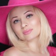 Beauty fashion girl portrait. Blond female in pink hat isolated — Stock Photo
