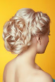 Hairstyle. Beauty Blond girl bride with curly hair styling over  — Stock Photo