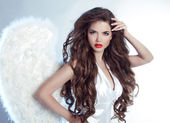 Fashion Beautiful Angel Girl model with wavy long hair — Stock Photo