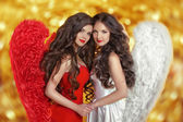 Two Fashion Beautiful Angels Girls models with curly long hair — Stock Photo
