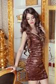 Glamorous beautiful girl model with long wavy hair. Female posin — Stock Photo