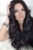 Beauty Portrait of brunette model with long wavy hair. Sensual y — Stock Photo