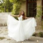 Beautiful  bride woman in luxurious white wedding dress posing o — Stock Photo #48998003