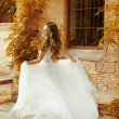 Beautiful bride woman in white wedding dress running at autumn p — Foto de Stock   #48998029