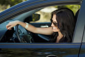 Smiling woman sitting in car, Happy girl driving automobile, out — Stockfoto