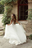 Happy bride woman running in wedding dress at park, outdoors por — Stock Photo