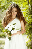Beautiful young bride holding bouquet of spring flowers with wed — Stock Photo
