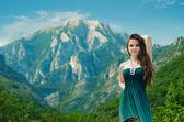 Beautiful girl enjoying  valley view nature over mountain landsc — Stock Photo