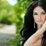 Beauty portrait of brunette model woman posing on nature backgro — Stock Photo #49437277