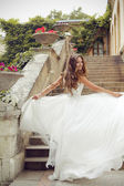 Happy beautiful bride running in blowing wedding dress. Fashion  — Stock fotografie