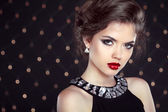 Beautiful brunette woman model with makeup and hairstyle in fash — Stock Photo