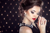 Jewelry. Beautiful brunette young woman. Fashion girl model over — Stock Photo