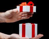 Hand with giftbox — Stock Photo
