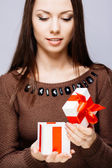 Gorgeous brunette with present — Stock Photo