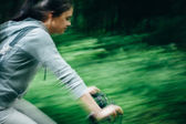 Girl on bicycle in forest — Stockfoto