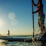 Women paddling stand up paddle board — Stock Photo