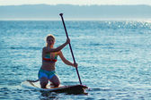 Women paddling stand up paddle board — Stock Photo