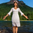 Stock Photo: Mother Nature with out stretched arms in front of Mountain