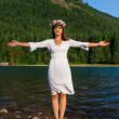 Mother Nature with out stretched arms in front of Mountain — Stock Photo