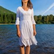 Mother Nature Standing in Water in Front of Mountain — Stock Photo #13558283