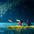 Lake Kayaking Couple — Stock Photo #13714422