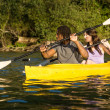 Lake Kayaking Couple — Stock Photo #13714453