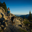 Beautiful Women Walking Dog in Mountains. — Stock Photo #13773748
