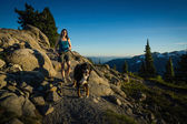 Beautiful Women Walking Dog in Mountains. — Stock Photo