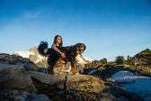 Beautiful Women Walking Dog in Mountains. — Stock Photo