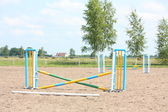 Show jumping vertical barrier at the training field — Стоковое фото