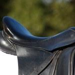 Black leather saddle close up — Stock Photo #41911985