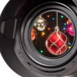 Christmas balls in camera lens - Stock Photo