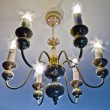 Stock Photo: Chandelier with energy-saving lamps