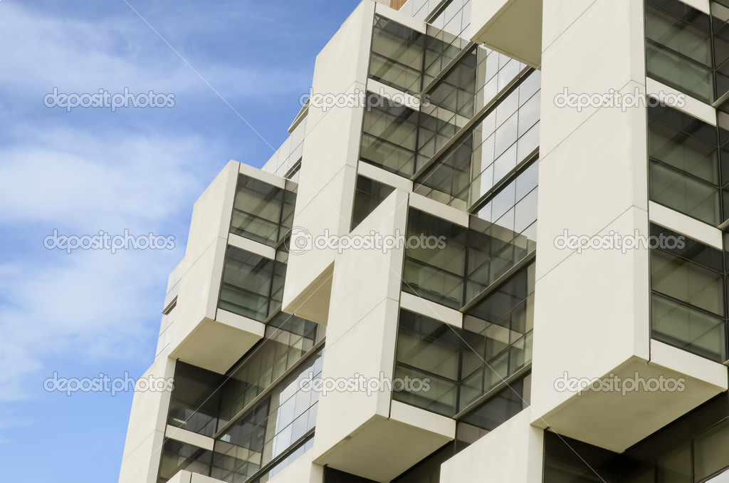 Part of office building on a blue sky — Stock Photo #13163677