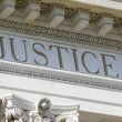 Royalty-Free Stock Photo: Justice engraved on courthouse