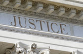 Justice engraved on courthouse — Stock Photo