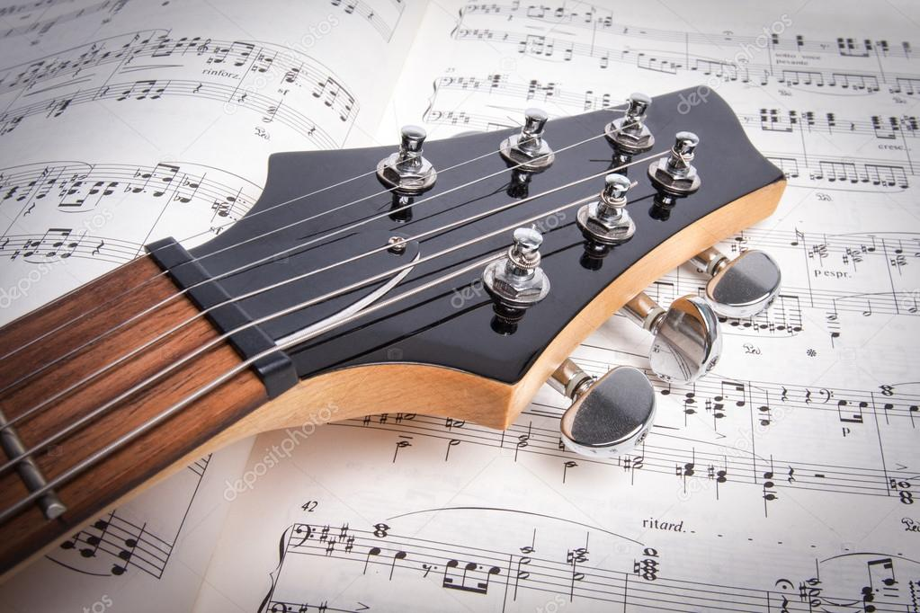 Detail of a black electric guitar — Stock Photo #12078605