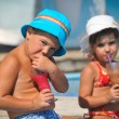 The brother and the sister drink juice — Stok fotoğraf #12447483