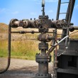 Industrial pipelines and valve - Stock Photo