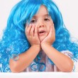 Little girl with blue wigs — Stock Photo