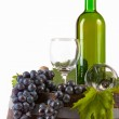 The glass of wine and old barrel and grape — Stock Photo
