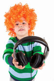 Smiling little boy listening to music in headphon — Stock Photo