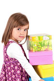 Picture of beautiful little girl with shopping bags on white background — Stock Photo