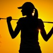 Girl playing golf on the sunset — Stock Photo #13915854