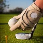 Beautifull girl playing golf — Stock Photo