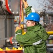 Stock Photo: The worker of the gas and oil refinery